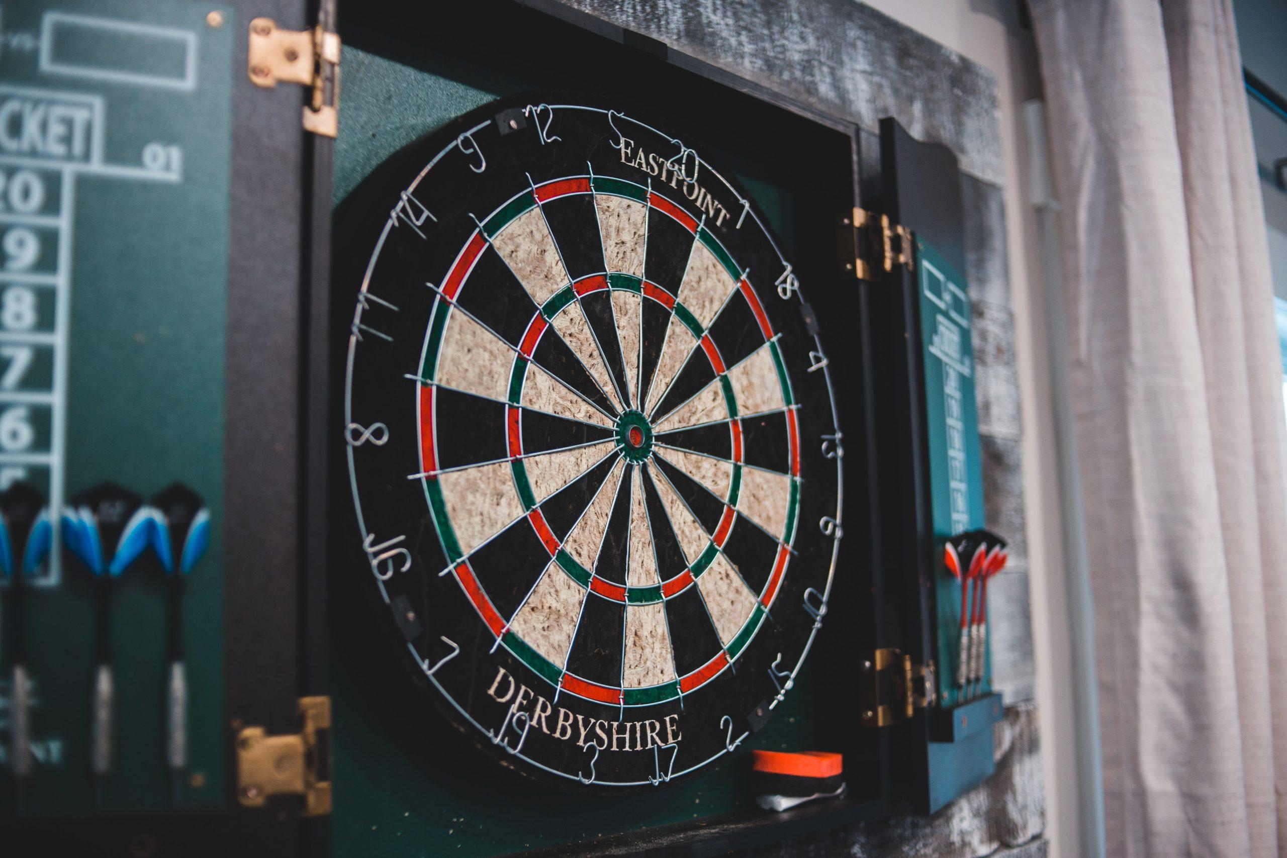 Darts at the moon and sixpence